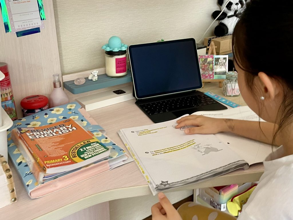 This is an image of a child studying at her desk