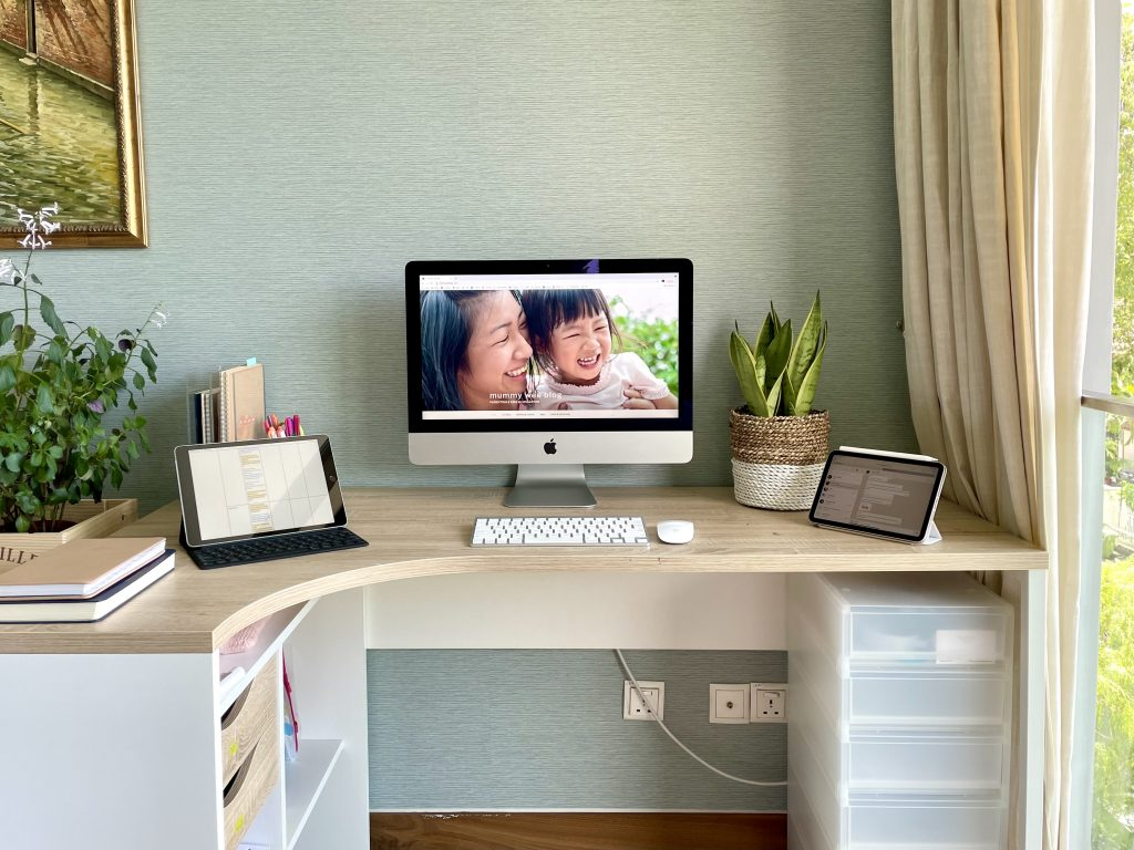 This is an image of a work station with a Mac and ipad